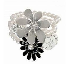 """""""Daisy Pearl Bracelet"""" ($32) This sweet charming pearl bracelet features a multilayer bead style and four daisies of different sizes with beautiful pearl or crystal in the middle.  This daisy pearl bracelet is a perfect gift for your sweetheart, friends and family."""