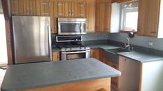 Pro #399354 | Ebbcast Corp. | Glen Cove, NY 11542 Pelham Manor, Leaking Basement, Glen Cove, Kitchen Remodel, Countertops, Kitchen Cabinets, Home Decor, Counter Tops, Kitchen Cabinetry