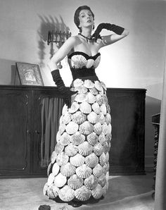 "Barbara Goalen is wearing the sea-shell dress from the series ""Crazy Clothes"", photo by Zoltan Glass, June 22, 1950"