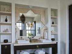 Alys Beach House Tour | This bathrooms Star Mirror, Brass Hardware and Fixtures are just right.