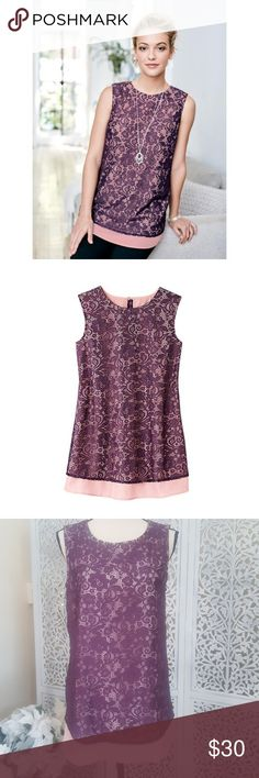 Layered Lace Top Lace is all the rage! This plum lace overlays a silky pink layer. The details continue to the back with a keyhole button closure.?  FEATURES Lace overlay with a silky layer underneath Keyhole button closure on back Sleeveless Rounded collar Plum lace has a floral print and stops short to allow a solid strip of pink to show on the bottom Runs true-to-size  MATERIALS Underlayer - 100% Polyester Lace - 96% Nylon 4% spandex  Item listed is size M. More sizes available at…