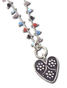 """Atria Necklace by Dana Evans Studio. This is a perfect small necklace for those days where you need a little extra lift. It matches great with the heart dangle earrings I have listed, and you can get it with a white, black, or multi-colored beaded chain, linked with a lobster clasp. It comes 16"""" long. The heart itself is 5/8""""/16mm long on an extra-thick jump ring. A great everyday necklace!"""