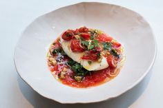 Slowly cooked halibut with tomatoes and almonds. On eye-swoon : http://eye-swoon.com/abc-kitchen-chef-dan-kluger/