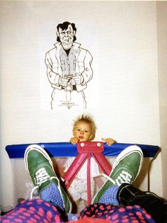 Kurt Cobain photographs daughter Frances Bean and his green Vans authentics.