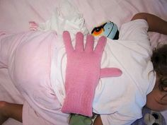 Put a bean filled glove on your baby's back when you want them to think your there while they sleep.