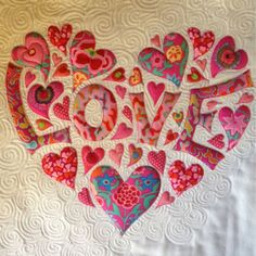 Sewing Applique: Stunning heart by Laura Lobb at Laura in Stitches. Stunning heart by Laura Lobb at Laura in Stitches. I could see doing this as a memory quilt. Love-Heart small (c) Laura Lobb 2014 Diy: Use patterned papers or pattern for coloring LOVE, s Patchwork Quilting, Applique Quilts, Mini Quilts, Baby Quilts, Heart Quilts, Quilting Projects, Quilting Designs, Sewing Projects, Applique Patterns