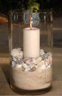 seashells in vase w/ candle