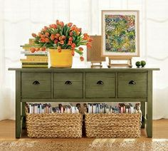 Baskets for extra storage.  Want to paint my sofa table this green.