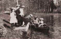 the-last-tsar:  Grand Duchess Maria (I think) looking at the camera while sailors help her father with the boat.