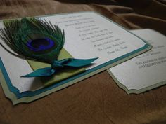 Handmade Perfect Plume Wedding Invitation- Genuine Peacock Feather. $5.00, via Etsy.