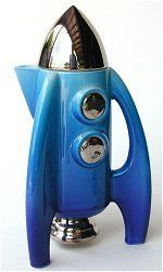 Blue Rocket teapot by Paul Cardew. Approximately 9 1/4 inches high by 5 1/4 inches wide. Made in England