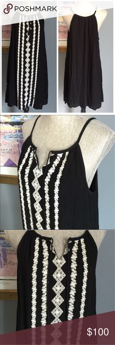 (S M L)Romeo + Juliet Couture Crochet Stitch Dress Beautiful black & ivory dress from Romeo + Juliet Couture !  Crinkle material with gorgeous crochet stitching down the front w/silver beading added to the center .  Tassel front ties which can be worn tied or dangling for two different looks .  Fully lined .  Made of 100% rayon .  Lining made of 100% polyester . Romeo + Juliet Couture Dresses