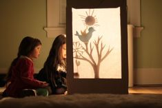 Handmade shadow puppet theater! She made it from a large moving box. Noah would LOVE this!