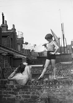 Back Garden Cabaret: Two young ballet dancers, Violet Hutchinson aged and Betty Putt aged rehearsing in a back garden in Poplar, east London, June 1935 (Photo by Fox Photos/Getty Images) Old Pictures, Old Photos, London Pictures, Vintage Photographs, Vintage Photos, Bd Art, East End London, Vintage Circus, Back Gardens