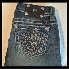 "Miss Me signature boot cut Fleur-de-Lys pockets 31"" inseam. Retails for $99.50. Please make me an offer using the offer button below.                        #229 Miss Me Jeans Boot Cut"