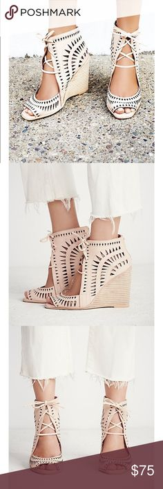 New FREE PEOPLE Jeffrey Campbell Leather wedge. Laser cut leather wedges featuring on open toe,adjustable lace up detailing and s stacked wedge. Padded footbed for extra comfort. Rubber sole Measurement: Wedge 4.5 in Shaft : 3.5 in Free People Shoes Wedges