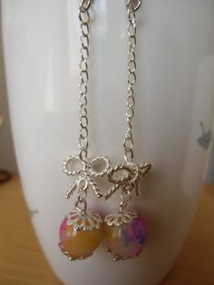 Silver ribbon with colorful beads cute dangle earrings.