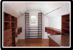 Walk-In Closet with Sloped Ceilings - like the shoe space at the end.