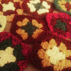 """Hello instagrammers! I lost my craft mojo for a while so have been very quiet but I am feeling inspired again so I am back. Here are some scrap busting granny squares I made recently - I think they are saying """"make me into a scarf""""  #crochet #instacrochet #igcrochet #crochetlove #grannysquare #craft #handmadewithlove #handmade by amelie_adores"""