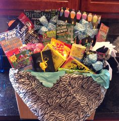 Gift basket for 10 year old boy- snacks, new wallet with cash or gift card tucked inside, X-box game, Pokeman cards, scratch off lottery tickets-to put in college fund if he wins ;-), socks, underwear, new shorts/t-shirts, swim trunks, new glove, baseballs, golf balls or whatever sport they are involved in, book, DVD