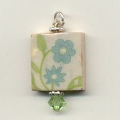 cute pendant made from a scabble tile