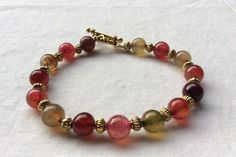 Multi colored  dragon vien gemstone bracelet with gold toggle clasp 8 inch by MoonBeamsJewels on Etsy