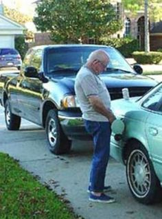 Dad Fills Up Neighbor's Gas Tank  -- best funny pictures walmart humor fail jokes