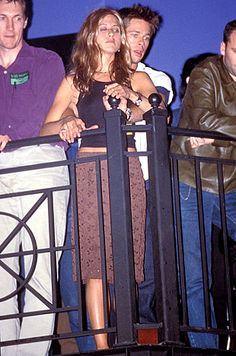 Jennifer Aniston & Brad Pitt - One of the 1st photographs together after they began dating in 1998 watching a concert in L.A. in June