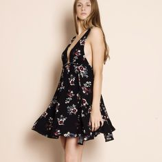 """Kiss and Tell"" Floral Print Mini Dress Deep plunge mini dress with gorgeous floral print. Get festival ready with this beautiful piece. Brand new. True to size but a loose fit. Tie waist. NO TRADES. PRICE FIRM. Bare Anthology Dresses Mini"