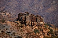 The Shahara Bridge – Yemen | Don't be put off by the  five-hour trek up a rocky mountain terrain. The bridge and the ancient fortress (Shahara) that it leads to are both worth the effort. #Adventure Travel