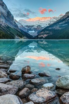 8.Dawn at Lake Louise in Banff, National Park, Alberta, Canada by Pierre rLeclerc Photography. Present a dish with ice, cold water and rough rocks. The rock is rough and textured and the ice is hard and cold. This may create a response and memory of the cold winter season and discussion of the Rocky Mountains.
