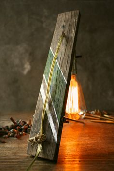salvaged wood, antique light bulb. sweet lamp.