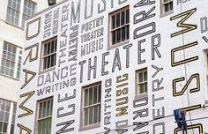 New Jersey Performing Arts Center by Pentagram 2001   Paula Scher created an interior and exterior design for the New Jersey Performing Arts Center. Words running along the walls; tubes and balconies reflecting with vast letters that gives a joyfully effect to represent the shows performance in the building.