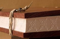 Handbound book by ortbindery with embossed edges #binding