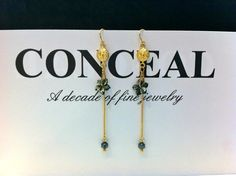 silver 18 carat gold plated earhooks with black mother of pearl flower & mini hematite balls