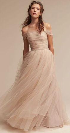 Obsessed with this blush tulle off the shoulder stunner.