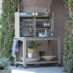 Gardening doesn't have to be back-breaking work, which is why we've got the Belham Living Cottonwood Wood Potting Bench - Driftwood . Outdoor Bar Cart, Outdoor Buffet, Outdoor Decor, Outdoor Furniture, Outdoor Rooms, Outdoor Ideas, Outdoor Living, Kitchen Hutch, Kitchen Storage