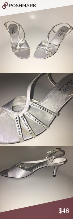 Beautiful Rhinestone Studded Silver Heels Beautiful silver shoes with rhinestone detail by Nina.  •Never Worn, New In Box;  •Size 10M •Silver/Grey Touch of Nina Shoes Heels
