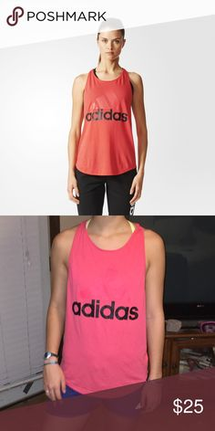 NWOT Adidas pink tank top Super cute never worn. Popped the tags when I got it. Willing to trade!! :) Adidas Tops Tank Tops