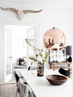 tom dixon copper shade pendant...dining area...white rustic horns...via Femina