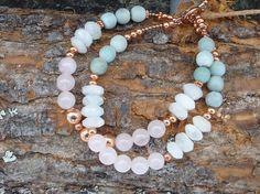 Armbånd med rosenkvarts, kobber og andre stener  Also on Etsy. The Bracelet is made by me   https://www.etsy.com/no-en/listing/224530423/pastel-gemstone-copper-bracelet-rose?ref=shop_home_active_13
