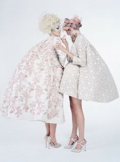 Birley wears Giambattista Valli Haute Couture coat and shoes; Ashley Lloyd headpiece. Delevingne wears Giambattista Valli Haute C...