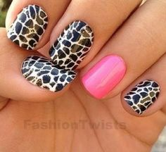 Black and white girraffe nail art design with pink accent.