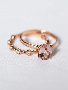 Rose GoldOvalEngagement Ring A flawlessly simple oval blushmorganite gem, set atop a tapered 14K rose gold band. This solitaire engagement ring effortlessly combines classic sophistication with modern style.Geneviève makes a unique, engagement ring and couples perfectly with our Fleur wedding band.   DETAILS & DIMENSIONS:Stone: Natural MorganiteCarat Weight: 0.91ctsSize: 6x8mmShape: OvalClarity: IF, AAARing Width: 2.0mmBand & Mounting: 14K Rose Gold  NOTES: Also availablewith a m...