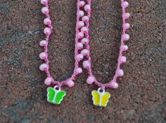 Butterfly pendant on a PINK beaded necklace by wandandwear on Etsy, $10.00