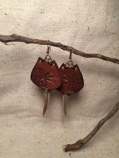 This listing is for the earrings pictured in the first two pics. The design is pressed into the leather. They are light weight and comfortable to wear and hang so beautifully.