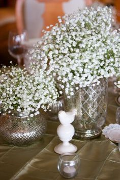 vintage wedding inspiration - perfect pairing of baby's breath and white bird
