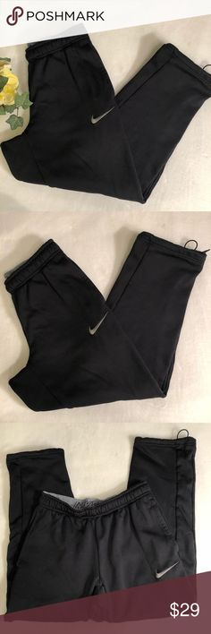 """Nike Black Therma Fit Crop Jogger Athletic Pants Nike Black Therma Fit Crop Jogger Pants. Black color with gray nike logo on front thigh. Elastic waistband with drawstring. Front pockets. Fleece lined. Therma-Fit style. Crop leg with drawstring. Joggers, workout, athletic pants. Size small. EUC, excellent used condition. No flaws. Measurements taken laid flat. 14.5"""" waist, 9"""" rise, 26.5"""" inseam, 7.5"""" leg opening. Nike Pants Track Pants & Joggers"""