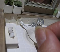 I can't help thinking that the socket is way too close to the faucet. | dollhouse miniatures