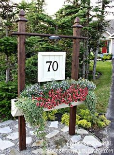 I'm going to repurpose our realtor's sign post for this in front of our new home. Waste not, want not.  Maybe hang a flower basket as pictured. Or the house numbers on a medallion sign. Or our name (well maybe not our name, don't want everyone knowing all that.) I could also hang some bird houses or mason bee houses and plant the parking he'll strip around the post. Or use the post to support my Little Free Library or Little Free Pantry/ Blessing Box. So many options!